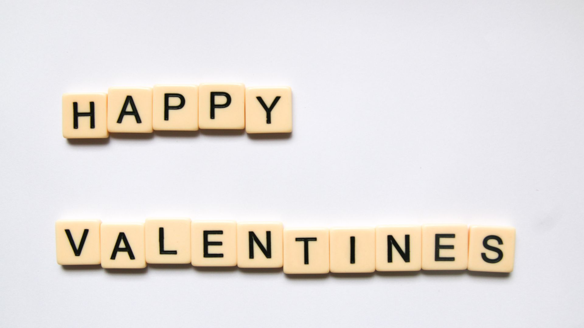 scrabble letters spelling out happy valentines