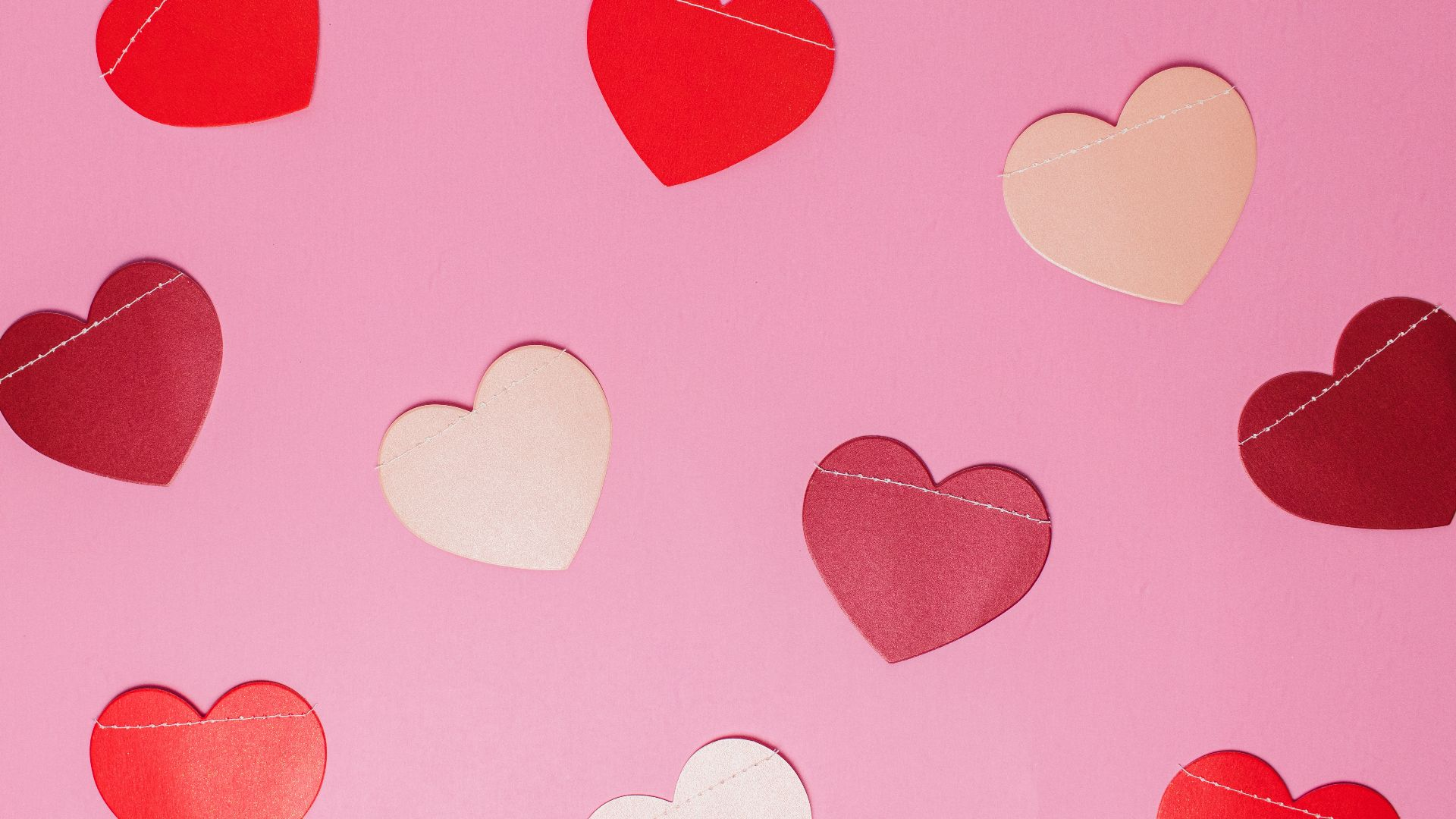 pink background with hearts in various shades of red