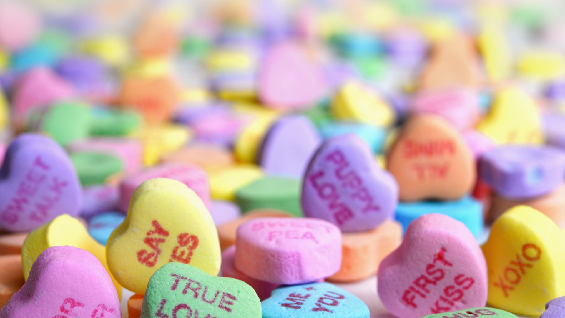 a colorful cluster of candy hearts