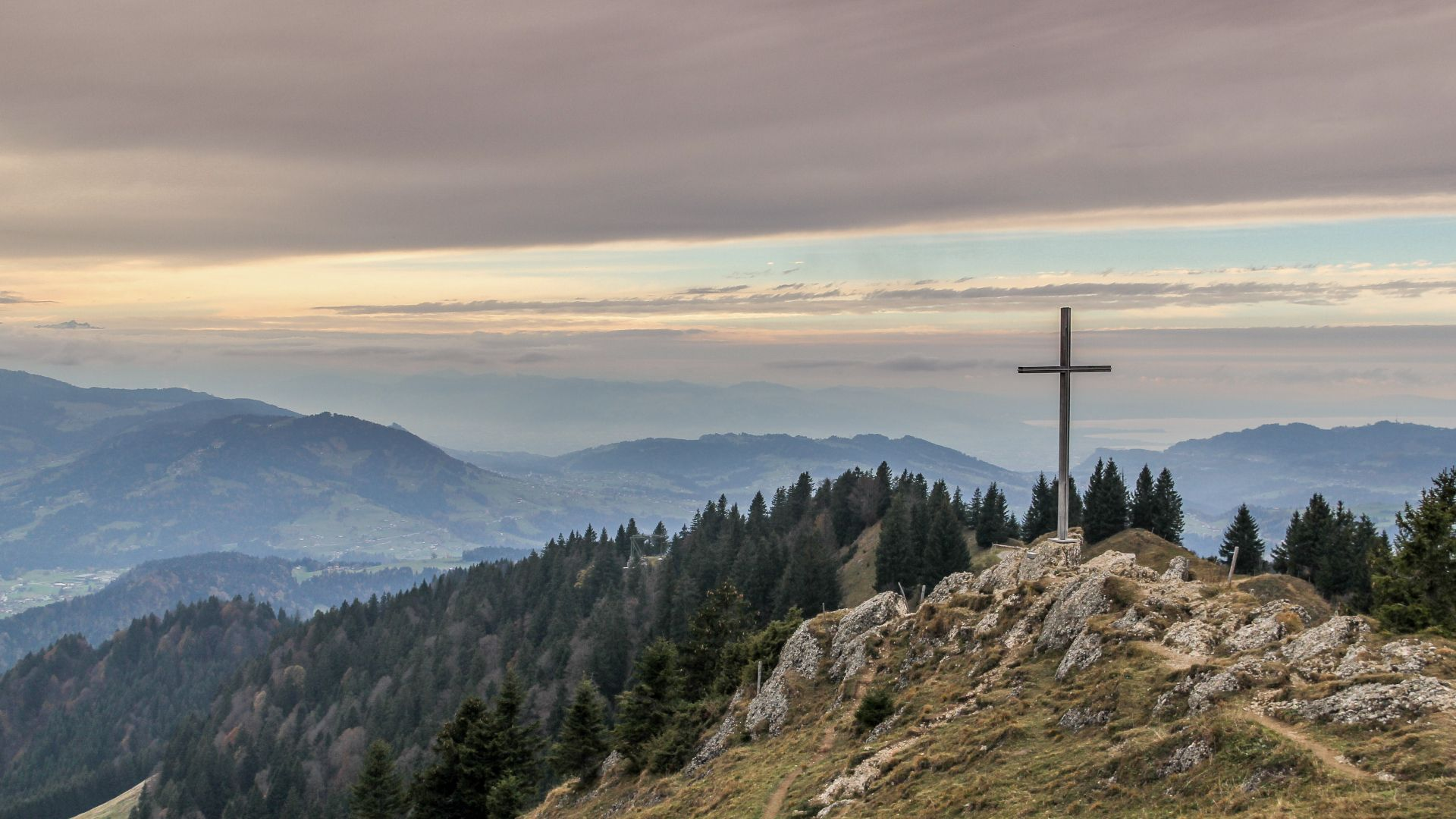 a picture of mountains and a cross